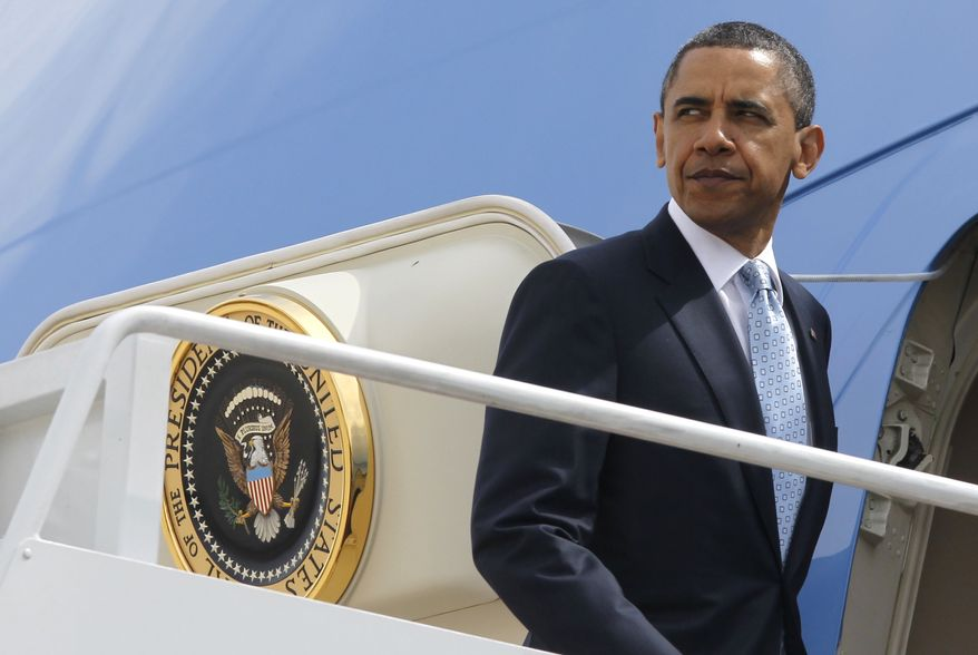 President Obama boards Air Force One at Andrews Air Force Base in Washington's Maryland suburbs on Tuesday, May 10, 2011, as he travels to the U.S.-Mexico border at El Paso, Texas, to speak about immigration reform. (AP Photo/Charles Dharapak)
