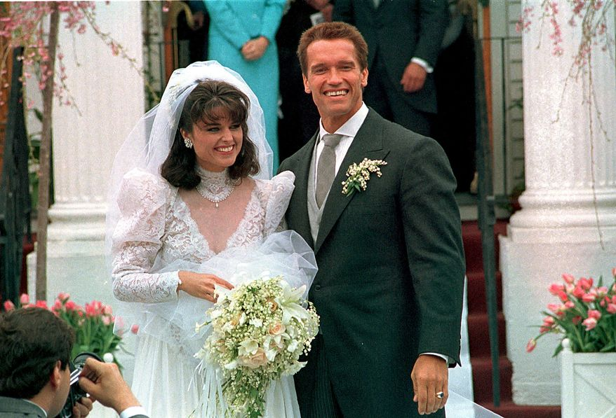 ** FILE ** In an April 25, 1986, file photo Actor Arnold Schwarzenegger poses with his bride Maria Shriver following their wedding ceremony in Hyannis, Mass. Former California Gov. Arnold Schwarzenegger and his wife of 25 years, Maria Shriver, announced Monday May 9, 2011, that they are separating. (AP Photo/file)