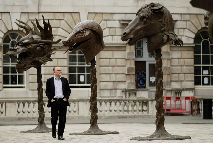 The unveiling Wednesday of 12 bronze animal heads by Chinese artist Ai Weiwei in the courtyard of London's Somerset House is part of a global reaction to the artist's arrest. The heads represent the Chinese zodiac. (Associated Press)