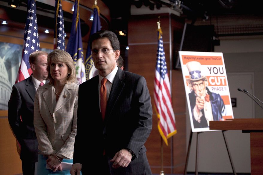 """ASSOCIATED PRESS Republicans (from left) Rep. Mick Mulvaney of South Carolina, Rep. Renee Ellmers of North Carolina and House Majority Leader Eric Cantor of Virginia leave a Wednesday news conference where they announced a strengthened revival of the """"YouCut"""" plan."""