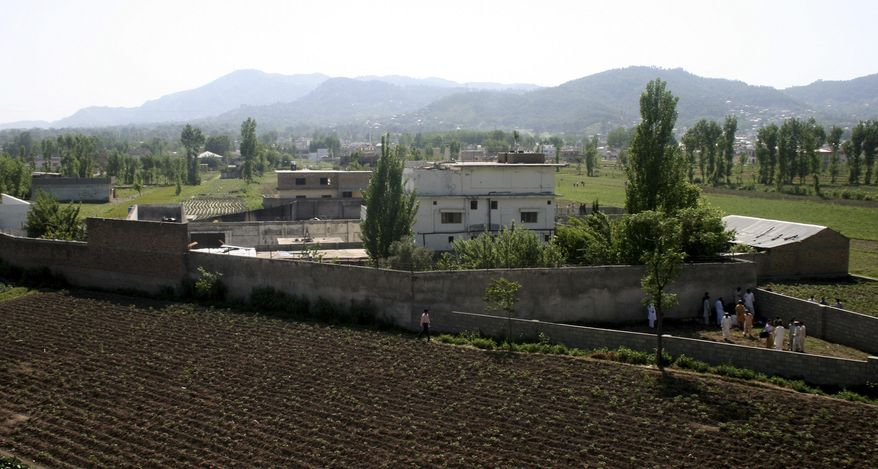 ** FILE ** This May 3, 2011 file photo shows a view of Osama bin Laden's compound in Abbottabad, Pakistan, the day after a U.S. military raid that ended with the death of the al-Qaida leader. (AP Photo/Aqeel Ahmed, File)