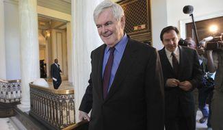 Former House Speaker Newt Gingrich leaves an Hispanic prayer breakfast Wednesday on Capitol Hill. (Associated Press)