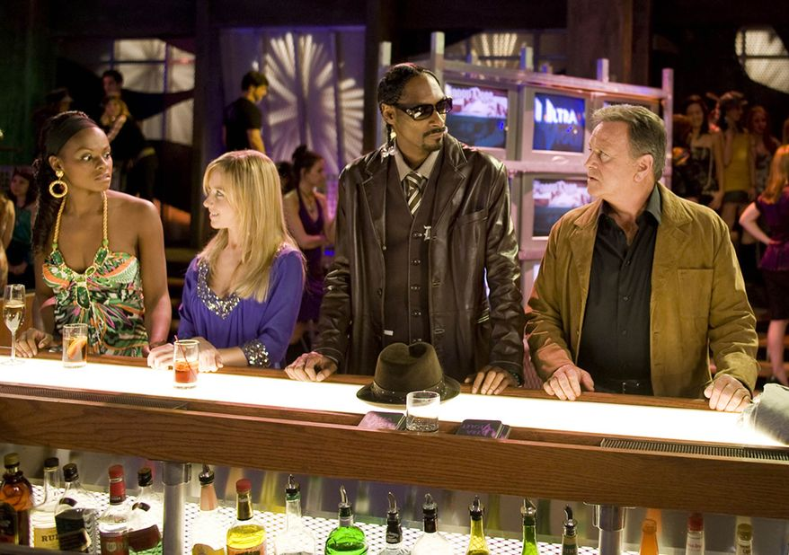 """Rapper Snoop Dogg (second from right) makes a guest appearance on the ABC soap opera """"One Life to Live,"""" on which actor Robert S. Woods (right) plays Bo Buchanan. The show, which the network has canceled, has received 12 Daytime Emmy nominations. (AP Photo/ABC, Steve Fenn)"""