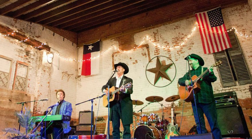 ASSOCIATED PRESS Kinky Friedman, who appears Friday at the Birchmere Music Hall, performs with his band, Kinky Friedman & the Texas Jewboys, last year in Conroe, Texas. His live performances are a freewheeling mix of music, comedy and book readings. He has run for public office, but has a dim view of politicians.