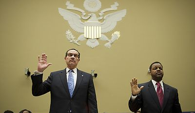 D.C. Mayor Vincent Gray (left) and City Council Chairman Kwame Brown are sworn in May 12 on Capitol Hill as they prepare to testify at a House Committee on Oversight and Government Reform subcommittee hearing on the city's budget. (Rod Lamkey Jr./The Washington Times)