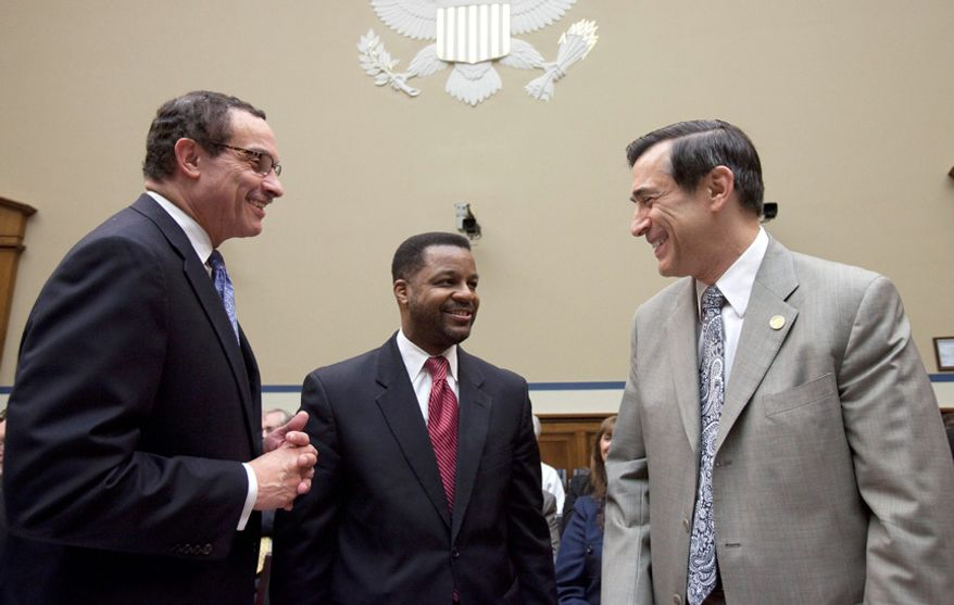 House Oversight and Government Reform Committee Chairman Darrell Issa, R-Calif ., right, talks with Washington D.C. Mayor Vincent Gray, left, and City Council Chairman Kwame Brown, on Capitol Hill in Washington, Thursday, May 12, 2011, prior to the start of a House Health Care, DC, Census, and the National Archives subcommittee hearing on the city's budget.  (AP Photo/Harry Hamburg)