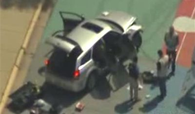 This frame grab from video courtesy KTVI Fox 2/KPLR11 shows authorities surrounding a vehicle on the Missouri University of Science and Technology campus Thursday, May 12, 2011, in Rolla, Mo. Officials say a gunman tried to break into a Missouri Army base and fired on police who pursued him before crashing a vehicle at the university, which went on lockdown after he was seen walking into a campus building. (AP Photo/courtesy KTVI Fox 2/KPLR11)