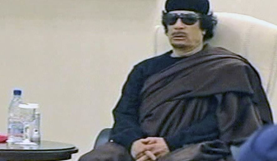In this image made from Libyan TV, Col. Moammar Gadhafi holds a meeting with tribal leaders from eastern Libya in Tripoli, Libya, on Wednesday, May 11, 2011. (AP Photo/Libyan TV via APTN)