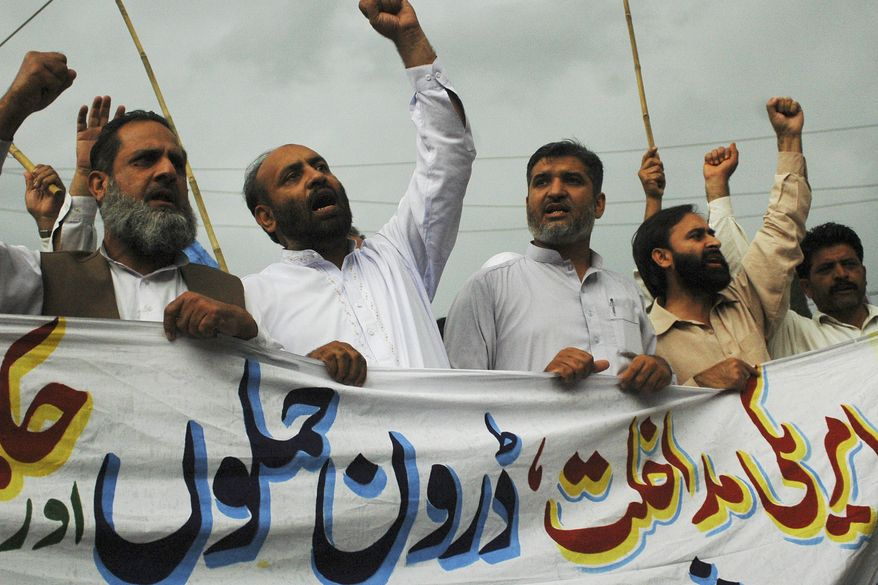 "**FILE** Supporters of the Pakistani religious party Jamaat-e-Islami rally in Rawalpindi, Pakistan, on May 6 to condemn the killing of al Qaeda leader Osama bin Laden and U.S. drone attacks on Pakistani tribal areas. The banner reads, ""We condemn U.S. interference and drone attacks."" (Associated Press)"