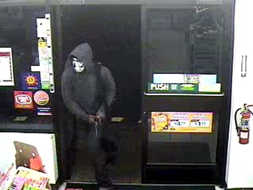 A surveillance photo shows a person Prince George's County police are seeking in connection with a homicide early Thursday at a Fort Washington convenience store.