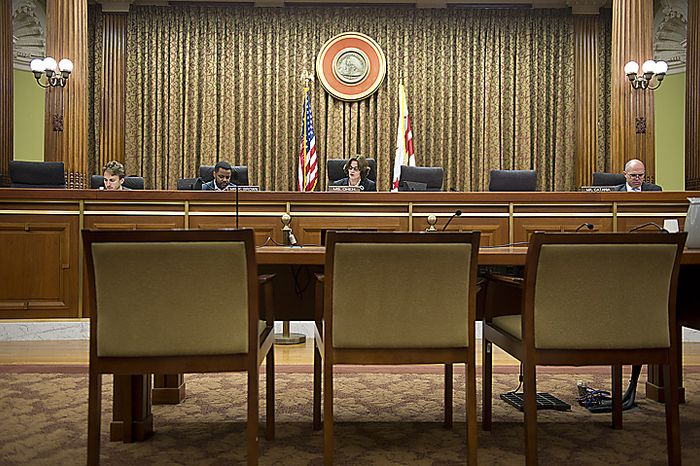 Before an empty witness stand at the Wilson Building, D.C. Council member Mary M. Cheh, center, along with council Chairman Kwame R. Brown, left, and council member David A. Catania, right. (Barbara L. Salisbury/The Washington Times)