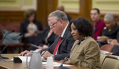Lorraine A. Green, chairman of Mayor Vincent C. Gray's campaign and head of his transition team, testifies at a hearing at the Wilson Building in Washington, D.C., on Friday, May 13, 2011 to discuss the hiring practices within the Gray administration. Next to Ms. Green is her attorney, Thomas C. Green. (Barbara L. Salisbury/The Washington Times)