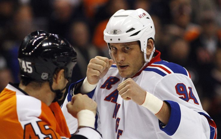 FILE - In this Nov. 4, 2010, file photo, Philadelphia Flyers' Jody Shelley, left, and New York Rangers' Derek Boogaard fight during an NHL hockey game in Philadelphia. Boogaard, at age 28, died on Friday. Boogaard signed with the Rangers as a free agent in July,2010 appearing in 22 games last season, registering one goal and one assist. (AP Photo/Matt Slocum, File)