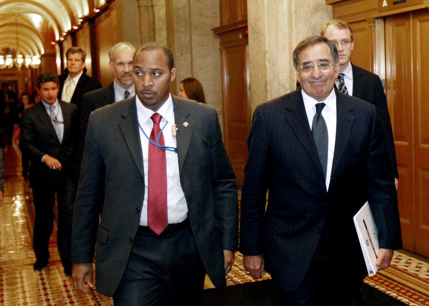 ** FILE ** In this May 3, 2011, file photo, CIA Director Leon Panetta, right, leaves after briefing members of Congress on Capitol Hill in Washington. Some members of Congress are making appointments at CIA headquarters to view graphic photos of Osama bin Laden's corpse. (AP Photo/Alex Brandon, File)