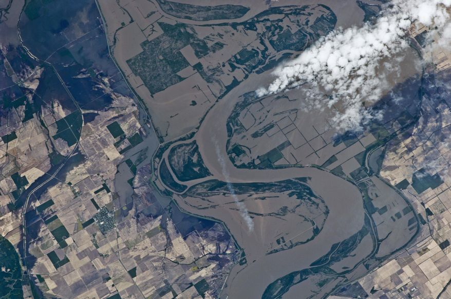 This image provided by NASA on Saturday, May 14, 2011, and taken by an Expedition 27 crew member aboard the International Space Station on May 12, 2011, clearly shows the outlines of some heavily flooded agricultural fields on the Missouri side of the Mississippi River. The center point for this frame is just north of Caruthersville, Mo., and west of Ridgely, Tenn. North is toward the lower right corner of the image. (AP Photo/NASA)
