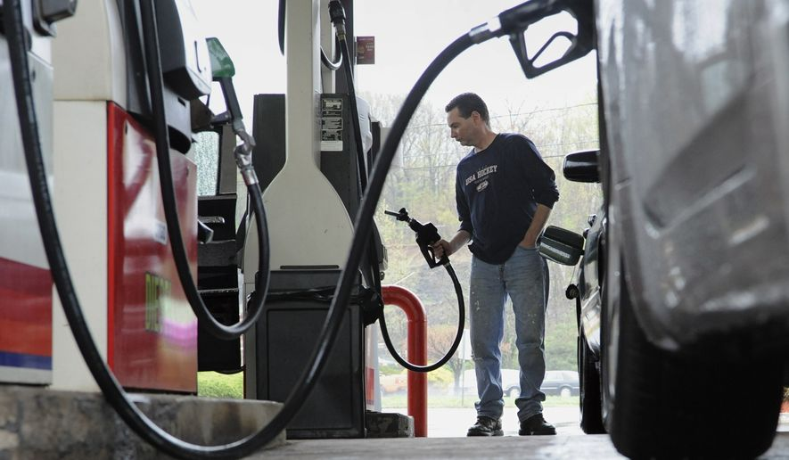 ** FILE ** In this April 28, 2011, file photo, John Magel pumps gas at a station in Wethersfield, Conn. (AP Photo/Jessica Hill, file)
