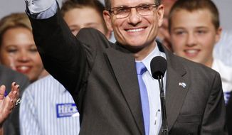 ** FILE ** In this Nov. 3, 2010, file photo Rep.-elect Joe Heck, R-Nev., greets supporters at an election night party after winning the U.S. congressional race in Las Vegas. (AP Photo/Isaac Brekken, File)