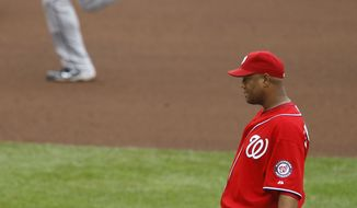 Washington Nationals starting pitcher Livan Hernandez, foreground, gives up a solo home run to Florida Marlins' Mike Stanton, top, during the seventh inning of a baseball game, Saturday, May 14, 2011, in Washington. (AP Photo/Luis M. Alvarez)