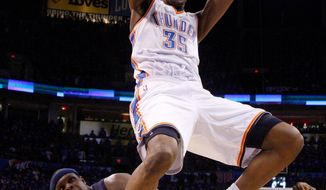 ASSOCIATED PRESS Oklahoma City forward Kevin Durant celebrates after slamming home a dunk over Memphis forward Zach Randolph. Durant scored 39 points as the Thunder advanced to the Westernn Conference finals with a 105-90 win.
