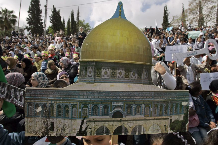"""Palestinian children, one holding a cutout of the Dome of the Rock, rally to mark the 63rd anniversary of the """"nakba,"""" or catastrophe, the Arabic term used to describe the uprooting of hundreds of thousands of Palestinians with the 1948 creation of the state of Israel, in the West Bank city of Nablus, on Sunday, May 15, 2011. (AP Photo/Nasser Ishtayeh)"""