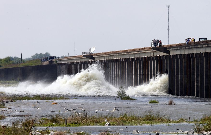 Water diverted from the Mississippi River spills through a bay in the Morganza Spillway in Morganza, La., on Saturday, May 14, 2011. A steel, 10-ton floodgate was raised for the first time in nearly four decades, unleashing a torrent of water from the river, away from heavily populated areas downstream. (AP Photo/Patrick Semansky)