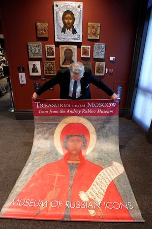 ASSOCIATED PRESS PHOTOGRAPHS Kent Russell, curator at the Museum of Russian Icons in Clinton, Mass., displays a poster for a canceled exhibition of Russian icons. The objects, lent by the Andrey Rublev Museum in Moscow, were sent back to Russia.