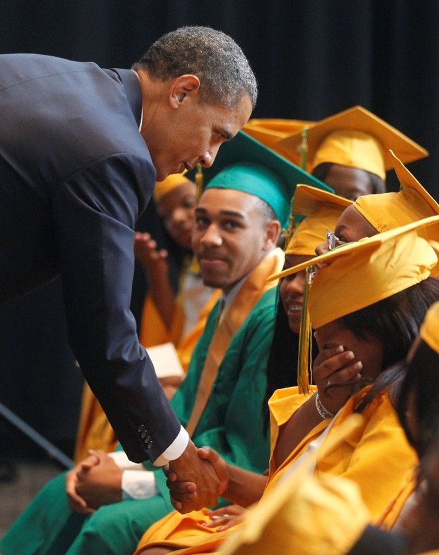 ASSOCIATED PRESS President Obama greets graduates, some overcome with emotion, before he delivers the commencement address at the Booker T. Washington High School graduation at Cook Convention Center in Memphis, Tenn., on Monday.