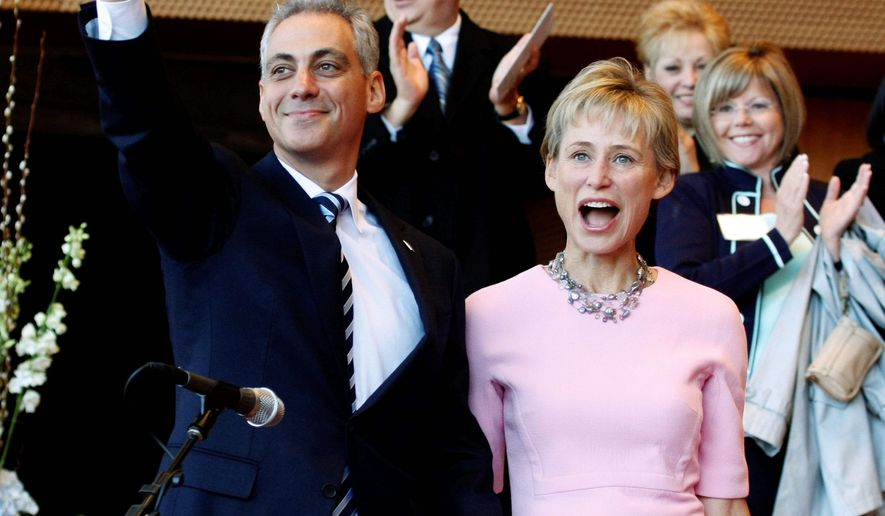 Rahm Emanuel and his wife, Amy Rule, acknowledge the crowd Monday before Mr. Emanuel 's swearing in as Chicago's mayor, succeeding Richard M. Daley. (Associated Press)