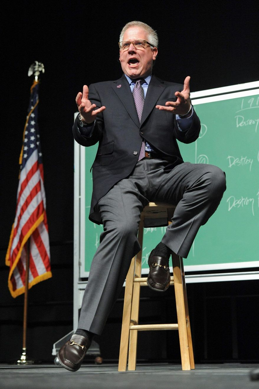 Political commentator Glenn Beck appears on stage in Anchorage, Alaska Saturday, Sept. 11, 2010. The event featuring the former Alaska Gov. and the conservative commentator Saturday night brought out two very different crowds. (AP Photo/Michael Dinneen)