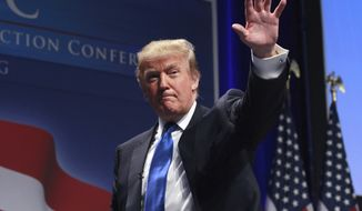 ** FILE ** Donald Trump waves after addressing the Conservative Political Action Conference (CPAC) in Washington on Thursday, Feb. 10, 2011. (AP Photo)