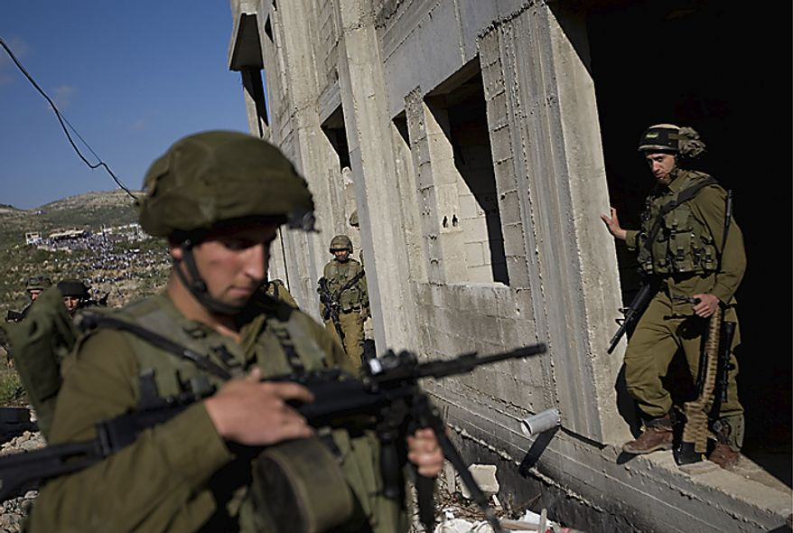 Israeli soldiers search a house on village of Majdal Shams in the Golan Heights on the border between Israel and Syria after Syrian demonstrators marking the anniversary of the mass displacement of Palestinians surrounding Israel's establishment in 1948 approached the Majdal Shams, Sunday, May 15, 2(...)