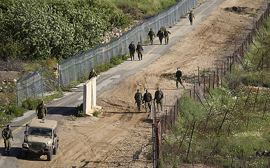 Israeli troops search for gaps in the fence along the border between Israel and Syria near the village of Majdal Shams in the Golan Heights, Monday, May 16, 2011. Mobilized by calls on Facebook, thousands of Arab protesters have marched on Israel's borders with Syria, Lebanon and Gaza on Sunday in a(...)