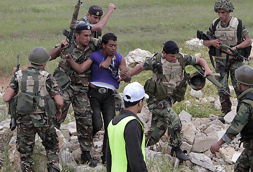 """Lebanese soldiers arrest a Palestinian protester during a rally marking """"nakba,"""" or """"catastrophe,"""" the term used by Palestinians to describe the uprooting they suffered at the time of Israel's founding on May 15, 1948, in the southern border village of Maroun el-Rass, Lebanon, Sunday, May 15, 2011. (...)"""