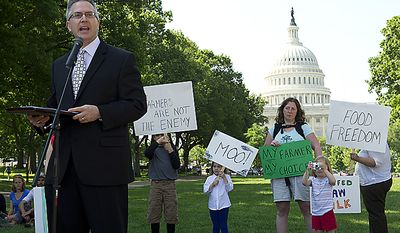 Jonathan Emord, attorney for the organization Grassfed on the Hill, speaks during a rally at Upper Senate Park in Washington, D.C., on Monday, May 16, 2011 to protest the sting operation the FDA conducted against Pennsylvania farmer Dann Allgyer and his private buying customers. The rally included samples of fresh milk, and Morgan the cow was also milked on site. (Barbara L. Salisbury/The Washington Times)