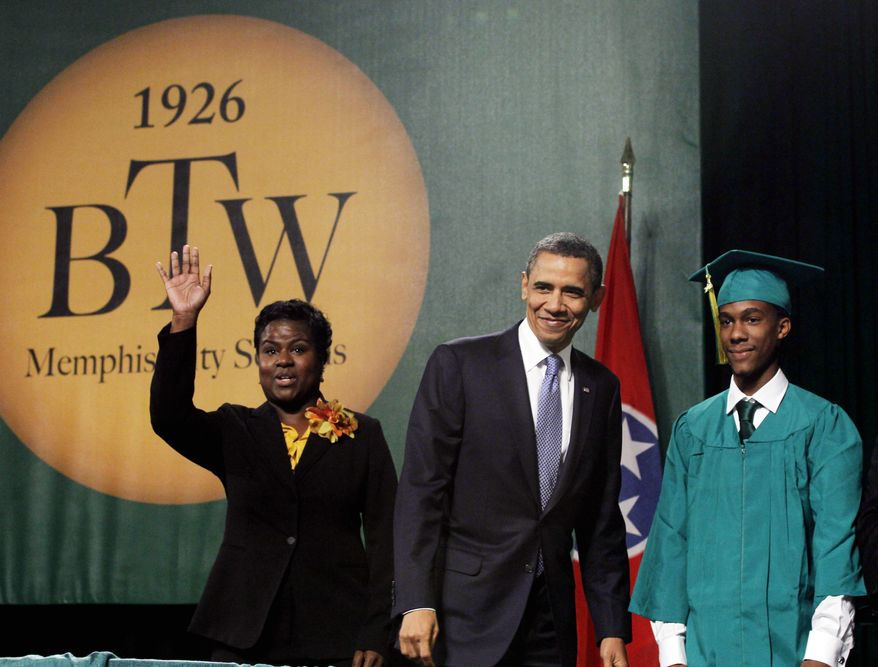 President Obama stands Monday with graduate Christopher Dean (right) and Principal Alisha Kiner before he delivers the commencement address at the Booker T. Washington High School graduation at Cook Convention Center in Memphis, Tenn. (Associated Press)