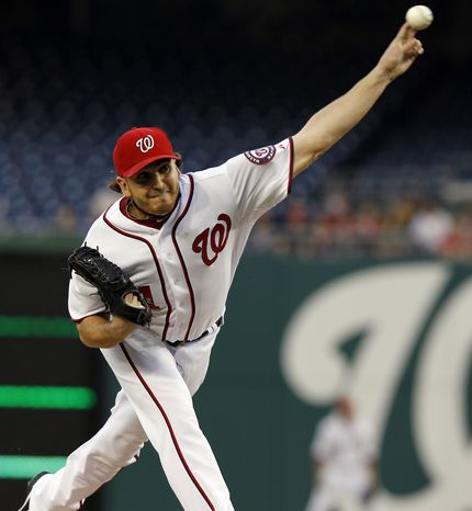 Washington Nationals pitcher John Lannan throws the ball during the first inning of a baseball game against the Pittsburgh Pirates at Nationals Park on Monday, May 16, 2011 in Washington. (AP Photo/Alex Brandon)