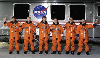 The crew of space shuttle Endeavour, from left, Canadian born U.S. astronaut Greg Chamitoff, mission specialist Drew Feustel, European Space Agency astronaut Roberto Vittori, of Italy,, mission specialist Mike Fincke, British born U.S. astronaut, pilot Greg Johnson and commander Mark Kelly, leave th(...)