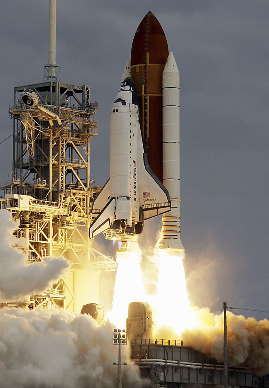 The space shuttle Endeavour lifts off from Kennedy Space Center in Cape Canaveral, Fla., Monday, May 16, 2011. The space shuttle Endeavour began a 14-day mission to the international space station. (AP Photo/John Raoux)