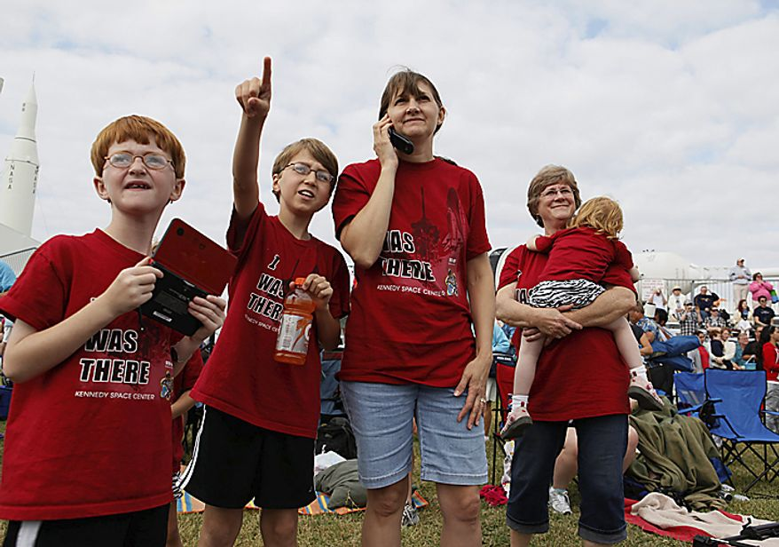Adam Wheeler, 8, Ryan Wheeler, 11, Debbie Wheeler, and Pegy Looten holding Erin Wheeler, all from Bowie, Md., watch space shuttle Endeavour after its launch from the Rocket Garden at the Kennedy Space Center Visitors Complex in Cape Canaveral, Fla., Monday, May 16, 2011. (AP Photo/Julie Fletcher)