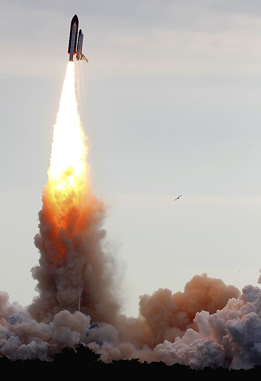 Space shuttle Endeavour leaves a smoke trail as it flies off the launch pad at Cape Canaveral, Fla., on Monday, May 16, 2011.  (AP Photo/Tim Donnelly)