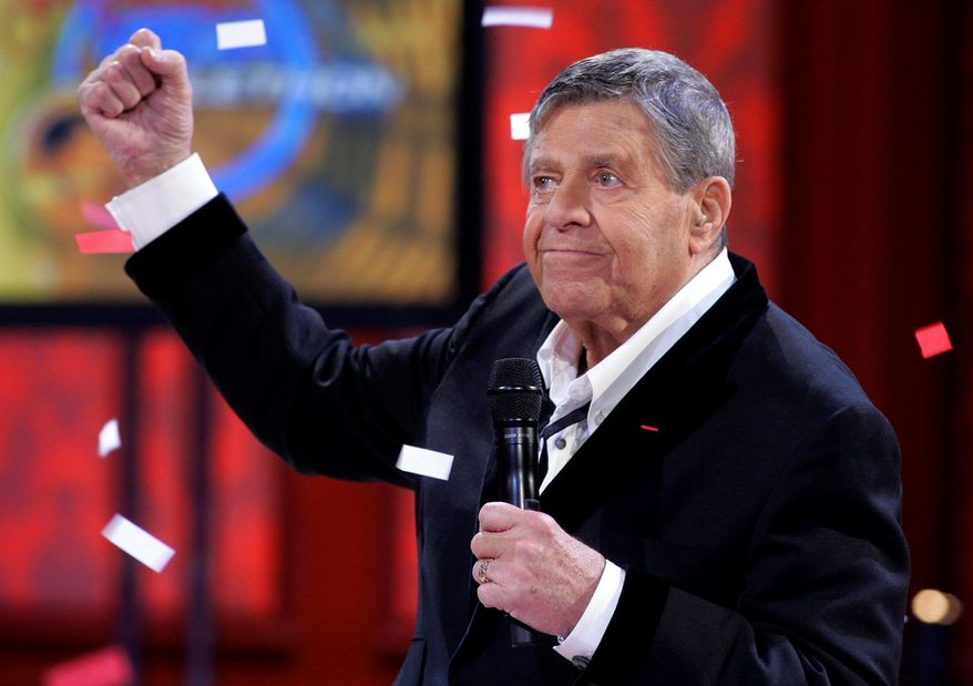 Jerry Lewis reacts to the final donations tally at the 2008 Labor Day muscular dystrophy telethon. This year's telethon will be his last as host. (Associated Press)