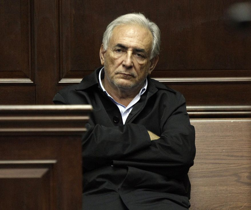 Dominique Strauss-Kahn, managing director of the International Monetary Fund, waits to be arraigned on Monday, May 16, 2011, in Manhattan Criminal Court for an alleged attack on a maid at a New York hotel near Times Square on Saturday. (AP Photo/Richard Drew, Pool)
