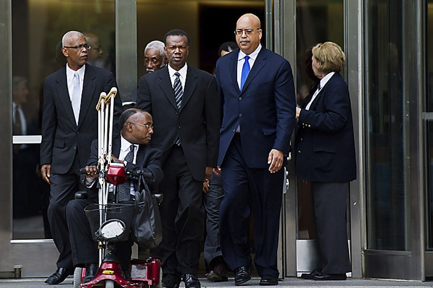 Former Prince George's County Executive Jack B. Johnson, center, exits the U.S. Federal Courthouse, in Greenbelt, Md., Tuesday, May 17, 2011. Johnson pleaded guilty to one count of extortion and one count of witness tampering. (Drew Angerer/The Washington Times)