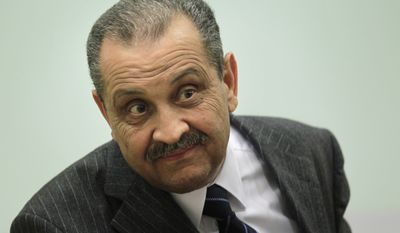 ** FILE ** Shukri Ghanem, Libyan oil minister and head of the state-run National Oil Corp., addresses a news conference in Tripoli, Libya, on Wednesday, March 9, 2011. (AP Photo/Jerome Delay, File)