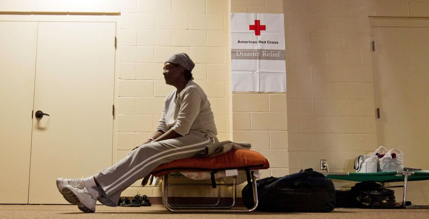 ASSOCIATED PRESS Flood victim Vivian Taylor-Wells can only sit and wait Wednesday at a Red Cross shelter in Vicksburg, Miss. She had just spent her second night in the shelter after funds for a motel ran out. She was forced from her home a week ago by the rising Mississippi River.
