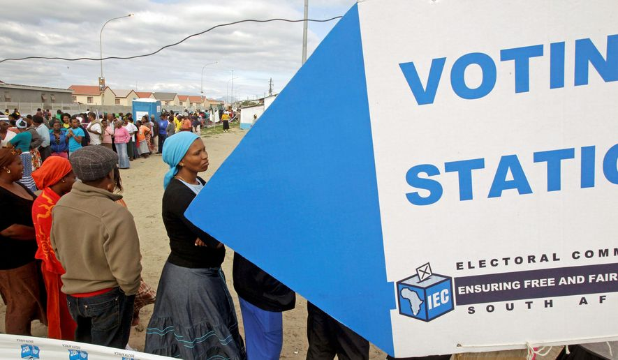 Voters line up to cast their ballots Wednesday for local leaders in a township on the outskirts of Cape Town, South Africa. Some 23 million voters were registered at 20,000 polling stations across this country, and the results are likely to have an impact on national politics. (Associated Press_)