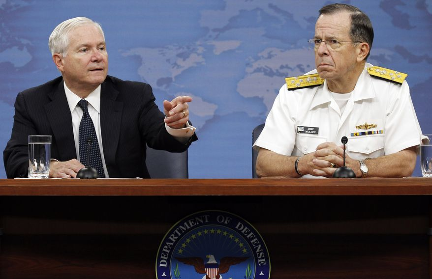 Secretary of Defense Robert M. Gates (left) and Adm. Mike Mullen, chairman of the Joint Chiefs of Staff, speak to the press at the Pentagon outside Washington on Wednesday, May 18, 2011. (AP Photo/Alex Brandon)