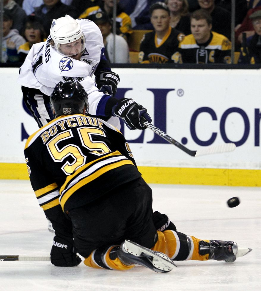 Tampa Bay Lightning center Steven Stamkos (91) shoots and scores as Boston Bruins defenseman Johnny Boychuk (55) tries to stop him in the third period of Game 2 of the NHL hockey Stanley Cup Eastern Conference final playoff series in Boston Tuesday, May 17, 2011. (AP Photo/Elise Amendola)