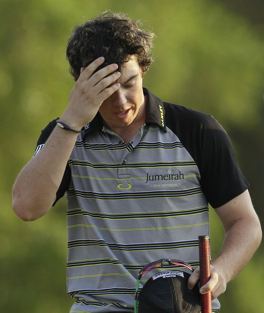 This April 10, 2011, file photo shows Rory McIlroy wiping his forehead after his final round of the Masters golf tournament, in Augusta, Ga. With the Masters meltdown firmly behind him, a reinvigorated Rory McIlroy intends to adopt a bullish approach as he bids to win his first tournament in 2011. The 21-year-old Northern Irishman went into the final round at Augusta National last month with a four-stroke lead, but hopes of landing his first major were dashed after shooting an 8-over 80 in a dramatic collapse to drop to 15th. (AP Photo/David J. Phillip, File)