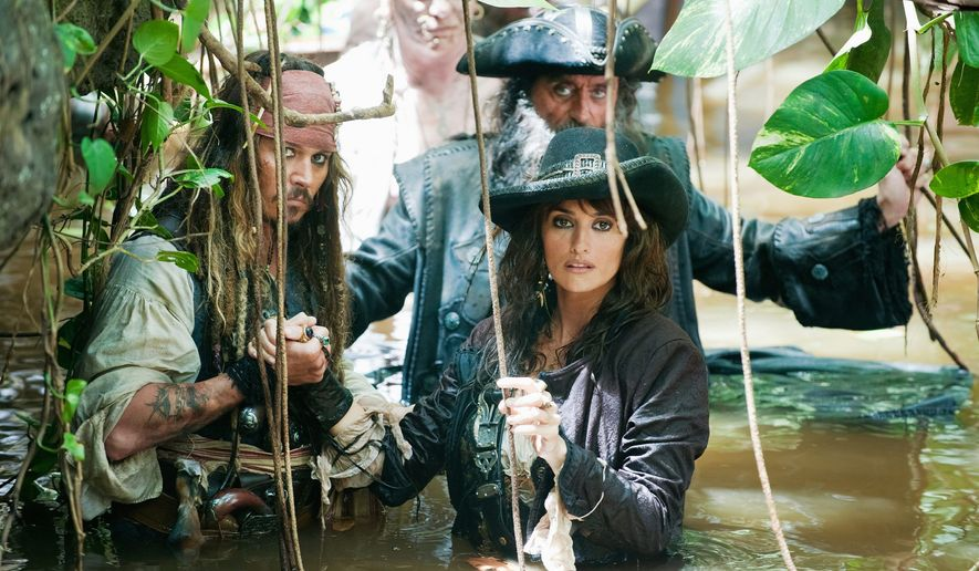"""Johnny Depp (left) as Jack Sparrow in """"Pirates of the Caribbean."""" (Associated Press)"""